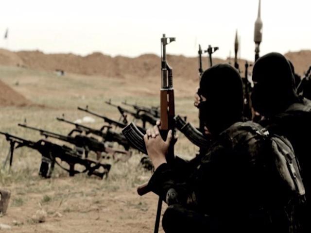 عناصر من داعش قبل هزيمة التنظيم المتطرف