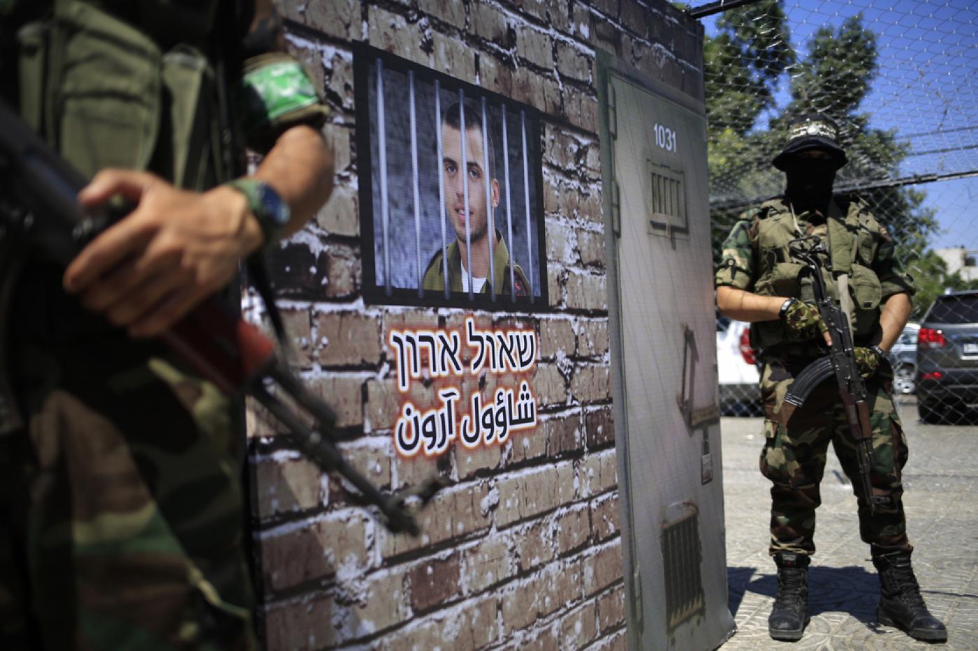 مقاتلون من القسام خلال عرض في غزة