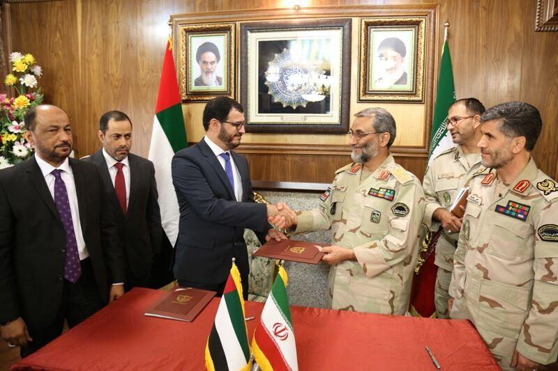 جانب من توقيع الاتفاقية بين إيران والإمارات