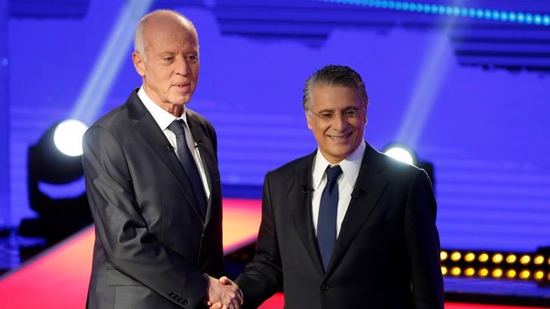 المرشحان للرئاسة في تونس نبيل قروي (يمين) وقيس سعيد
