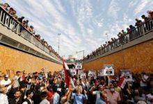 صورة إصابات باشتباكات بين متظاهرين وقوات الأمن في بغداد