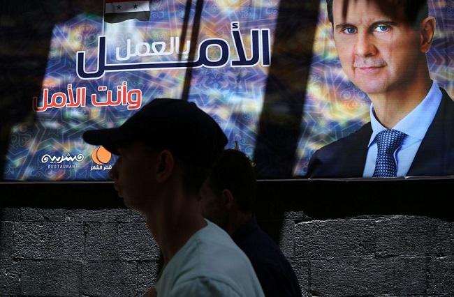 """بشار الأسد يستعد للتزوير وسط دمار هائل في """"الدولة"""""""